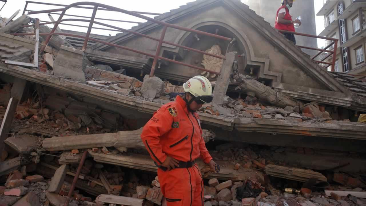 A Mexican rescue worker stands at the site of a building that collapsed in an earthquake in Kathmandu, Nepal, Tuesday, May 12, 2015.AP Photo/Niranjan Shrestha)