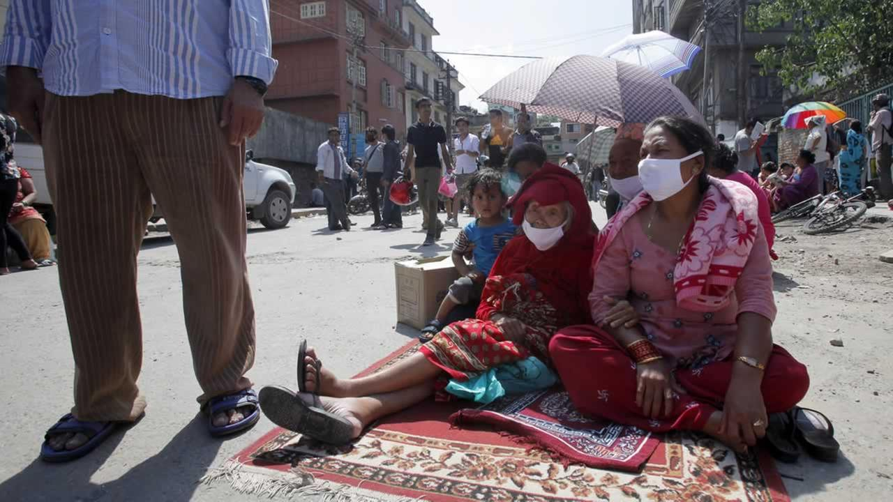 Nepalese people take refuge on a street after an earthquake hit Kathmandu, Nepal, Tuesday, May 12, 2015.AP Photo/Bikram Rai