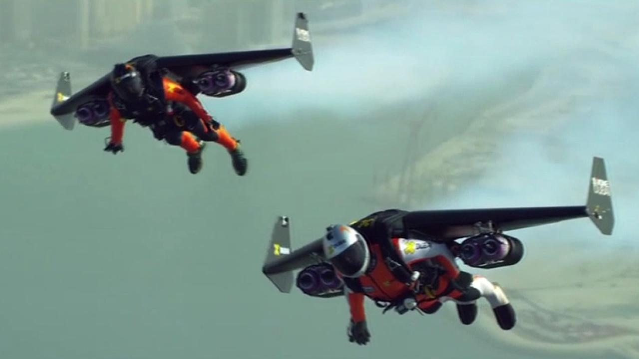 Jetman Yves Rossy and Vince Reffet use jetpacks to fly high above Dubai.