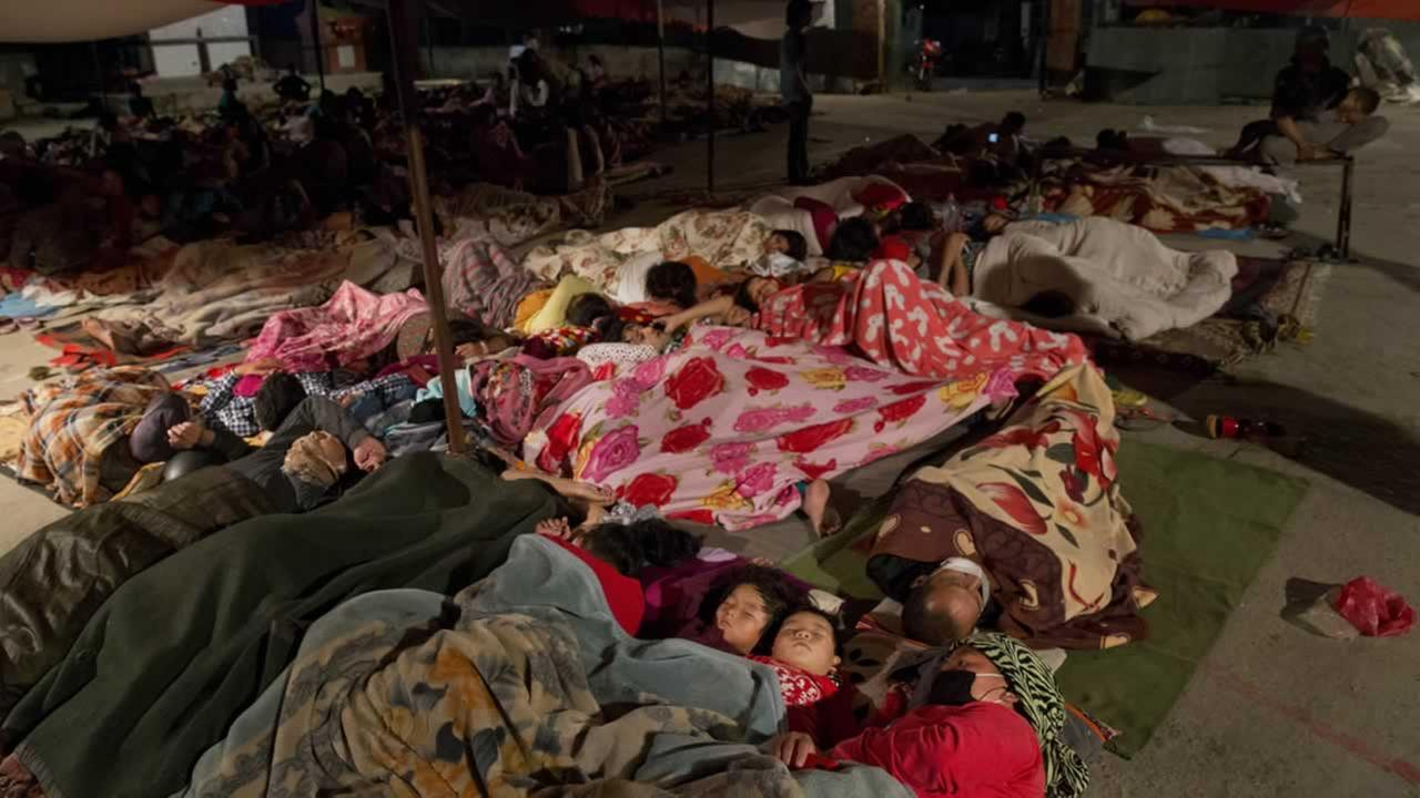 Nepalese sleep in an open space after an earthquake hit the region earlier in the day, in Kathmandu, Nepal, Tuesday, May 12, 2015. AP Photo/Bernat Amangue