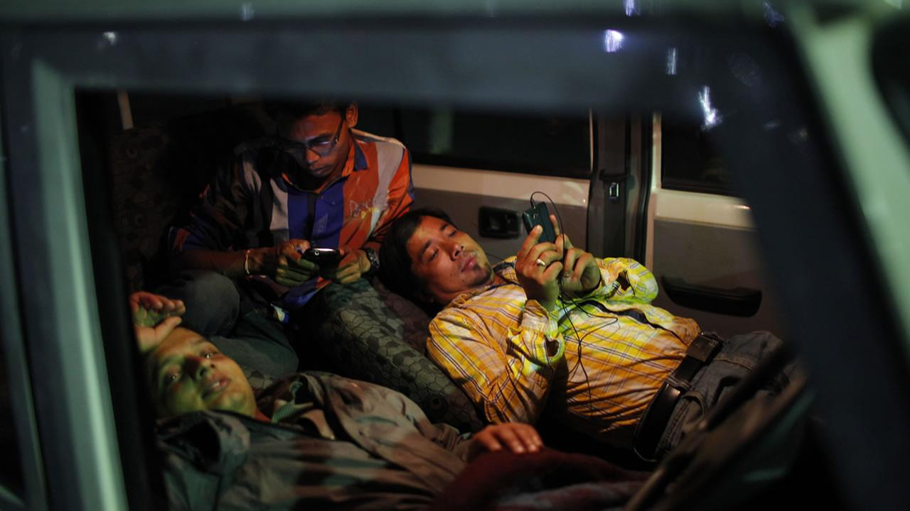Nepalese people take shelter inside a car considering it safer than being indoors after an earthquake struck earlier in the day in Kathamandu, Nepal, Tuesday, May 12, 2015. AP Photo/Niranjan Shrestha