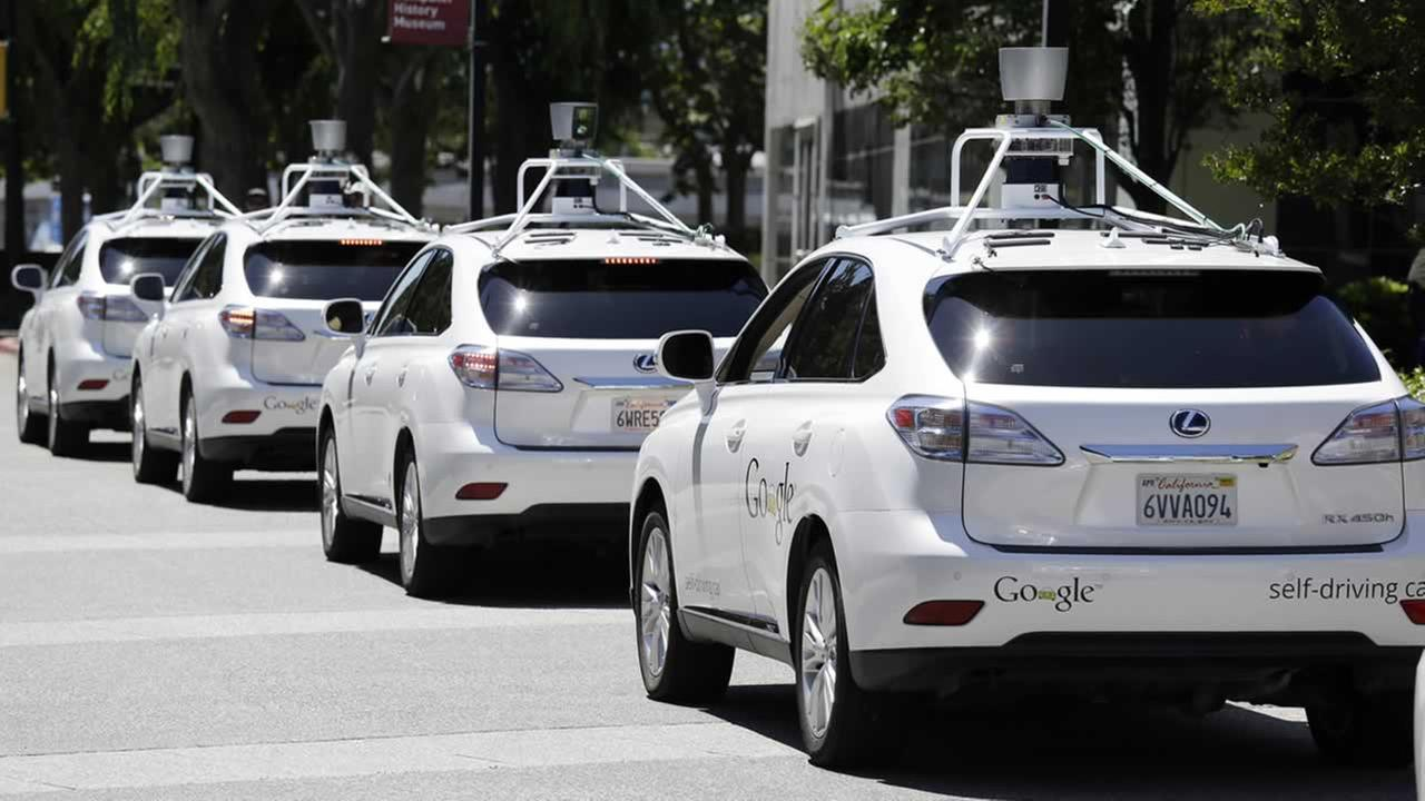 This May 13, 2014 file photo shows a row of Google self-driving Lexus cars at a Google event outside the Computer History Museum in Mountain View, Calif.