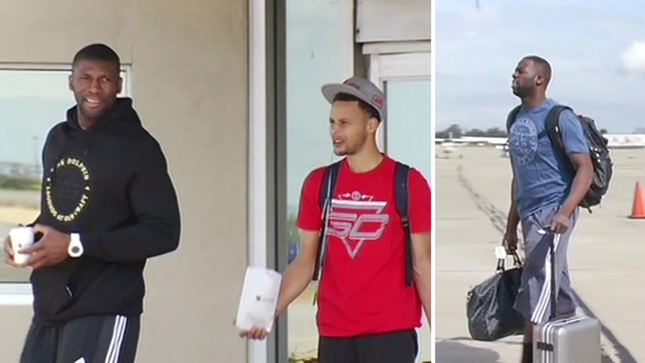 Golden State Warriors stars Festus Ezeli, Steph Curry, and Draymond Green prepare to board a plane in Oakland, Calif. on May 14, 2015.