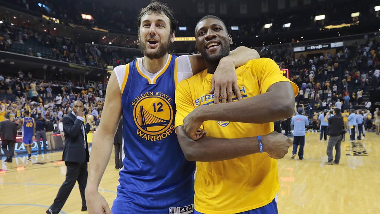 Golden State Warriors center Andrew Bogut celebrates with Festus Ezeli