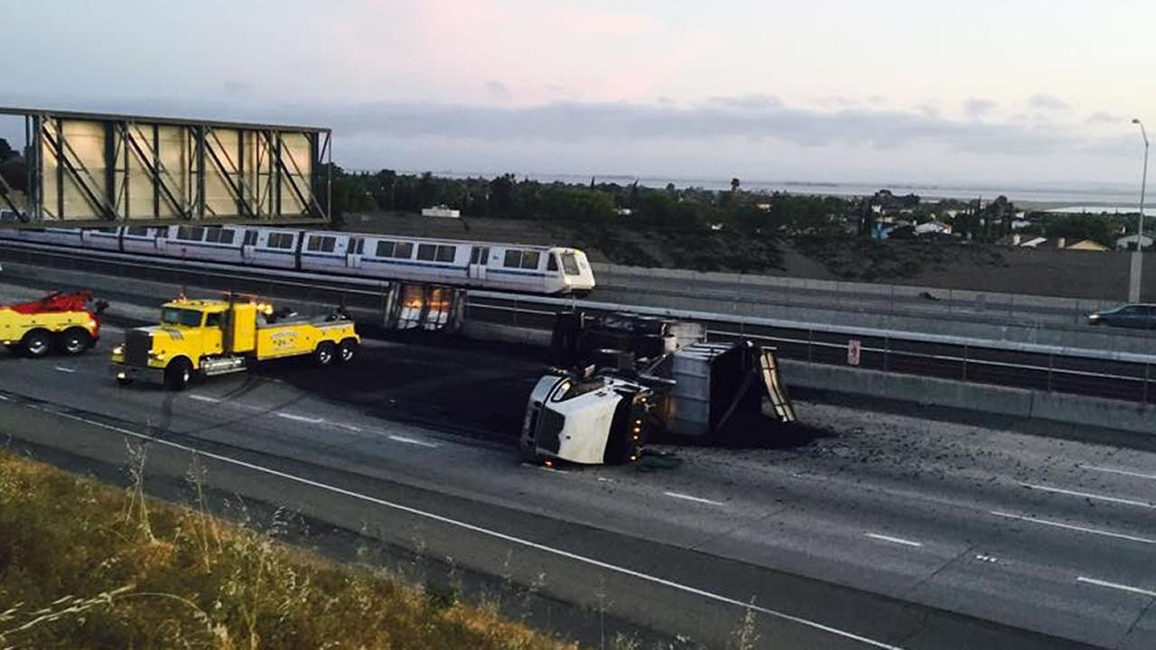 An overturned tractor trailer blocks left and center lanes on east CA-4 in Pittsburg, Calif. on Saturday, May 16, 2015.
