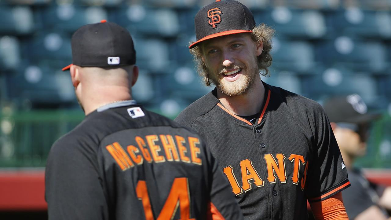 San Francisco Giants Hunter Pence, right, talks with Casey McGehee during batting practice during spring training baseball workouts Wednesday, Feb. 25, 2015, in Scottsdale, Ariz.
