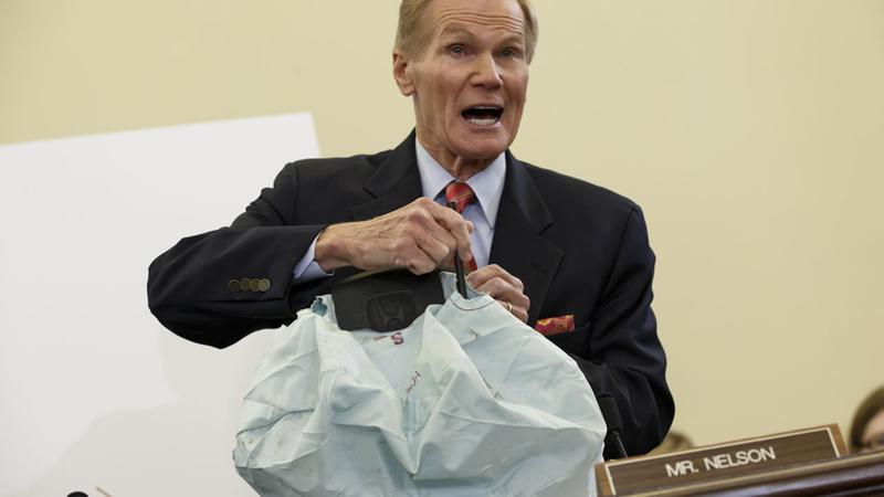 Senate Commerce Committee member Sen. Bill Nelson, D-Fla. displays the parts and function of a defective airbag made by Takata of Japan on Nov. 20, 2014. (AP Photo)