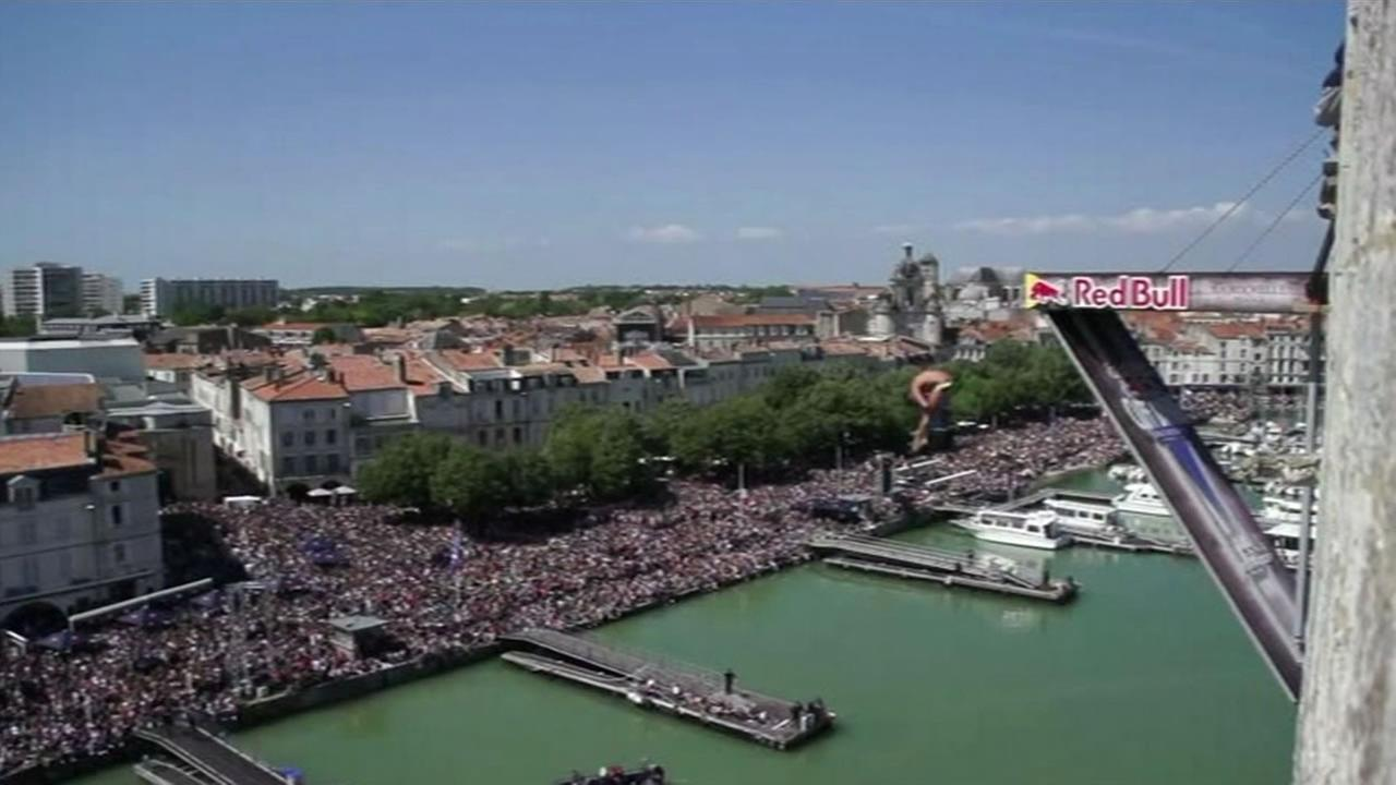An athlete dives from the platform on the 14th-century Saint-Nicolas Tower  during the Red Bull Cliff Diving World Series in La Rochelle, France on May 17, 2015.