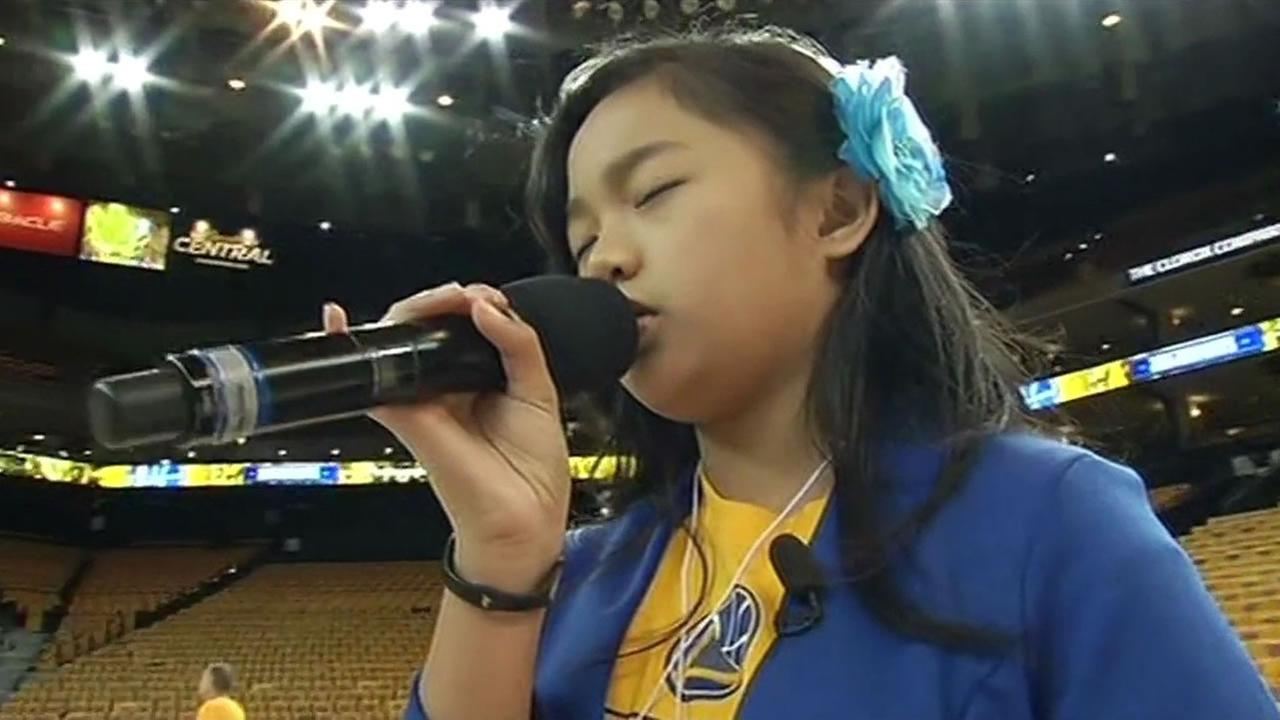 Nayah Damasen, 10, is tuning up for Game 1 of the Western Conference finals, a drill she has performed many times since she was 8.
