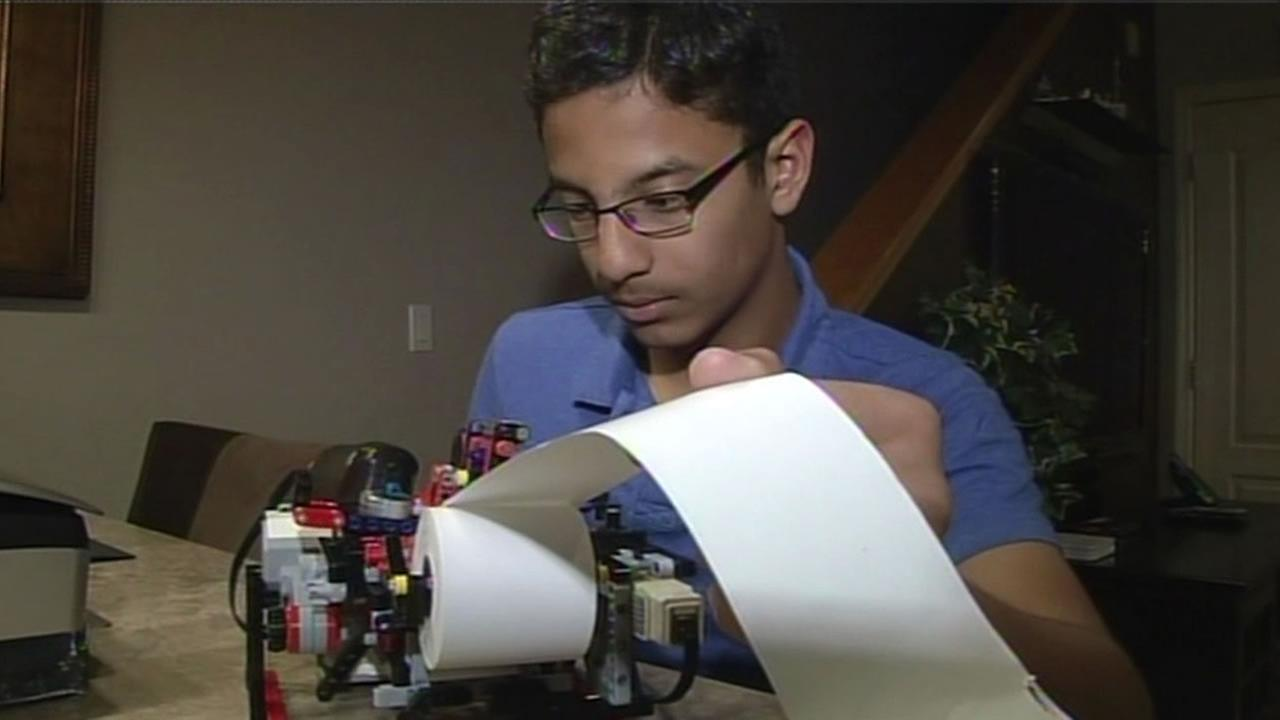 Santa Clara teen Shubham Banerjee shows off the braille printer that he made from his Legos robotics set.
