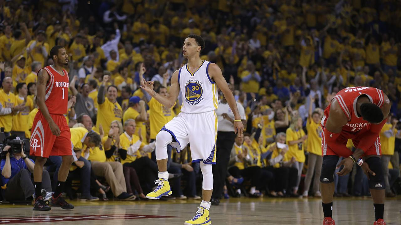 Golden State Warriors Stephen Curry, center, celebrates after a score during the first quarter of Game 1 of the NBA basketball Western Conference finals Tuesday, May 19, 2015. AP Photo/Ben Margot