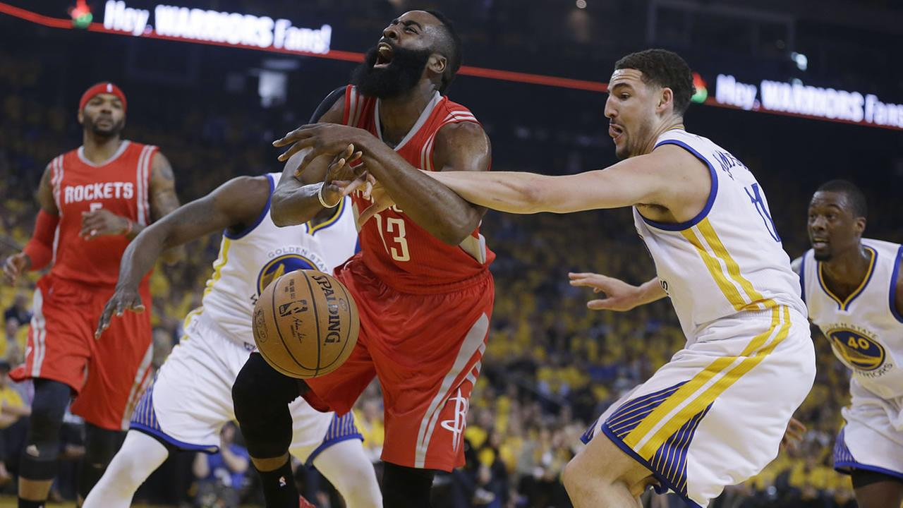 Golden State Warriors Klay Thompson, right, fouls Houston Rockets James Harden (13) during the first quarter of Game 1 of the NBA basketball Western Conference finals.AP Photo/Ben Margot