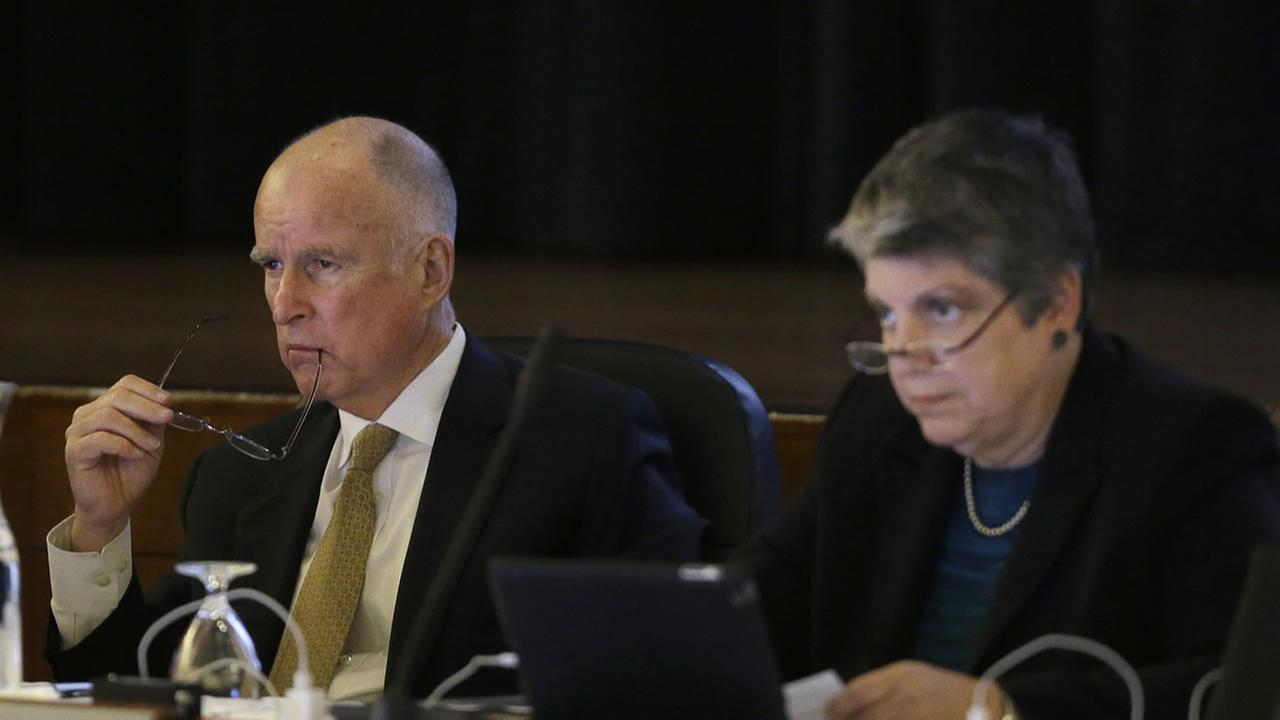 In this file photo California Gov. Jerry Brown, left, and University of California president Janet Napolitano listen to speakers at a UC Board of Regents meeting in San Francisco.