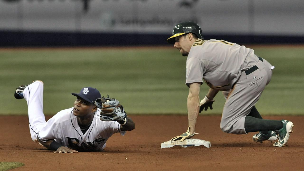Tampa Bay Rays infielder Tim Beckham, left, and Oakland Athletics Billy Burns look for the call after Burns beat Beckhams tag stealing second base during the fifth inning.