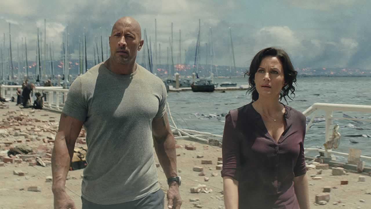 This photo provided by Warner Bros. Pictures shows Dwayne Johnson, left, as Ray, and Carla Gugino as Emma, in a scene from the action thriller, San Andreas.