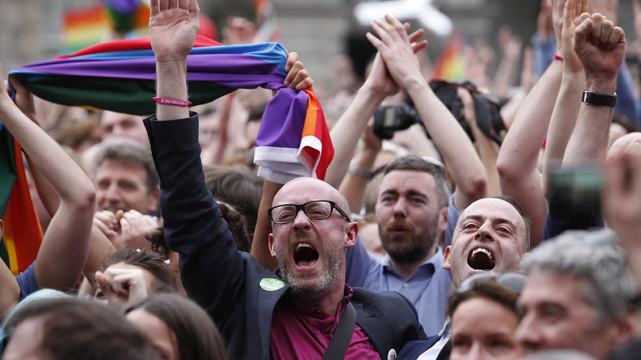 Yes supporters celebrate after the final result at Dublin castle, Ireland, Saturday, May 23, 2015.