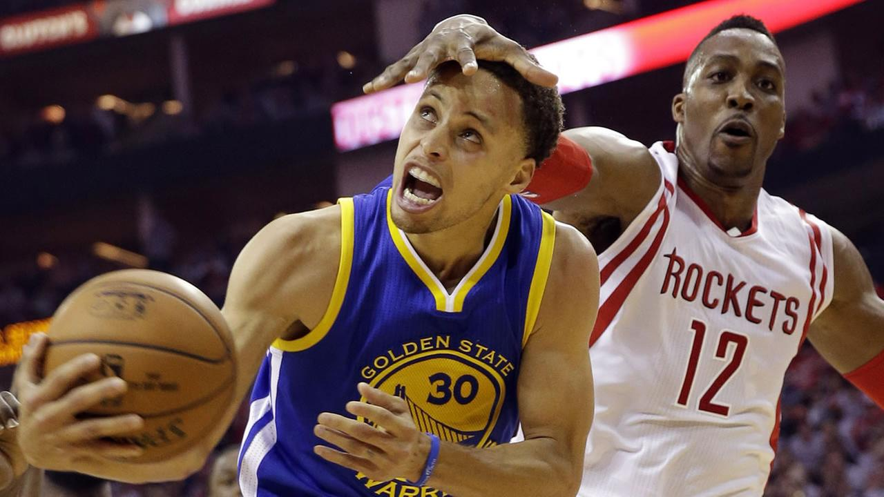 Rockets Dwight Howard fouls Warriors Stephen Curry during the first half in Game 3 of the NBA basketball Western Conference finals on May 23, 2015, in Houston. (AP Photo)