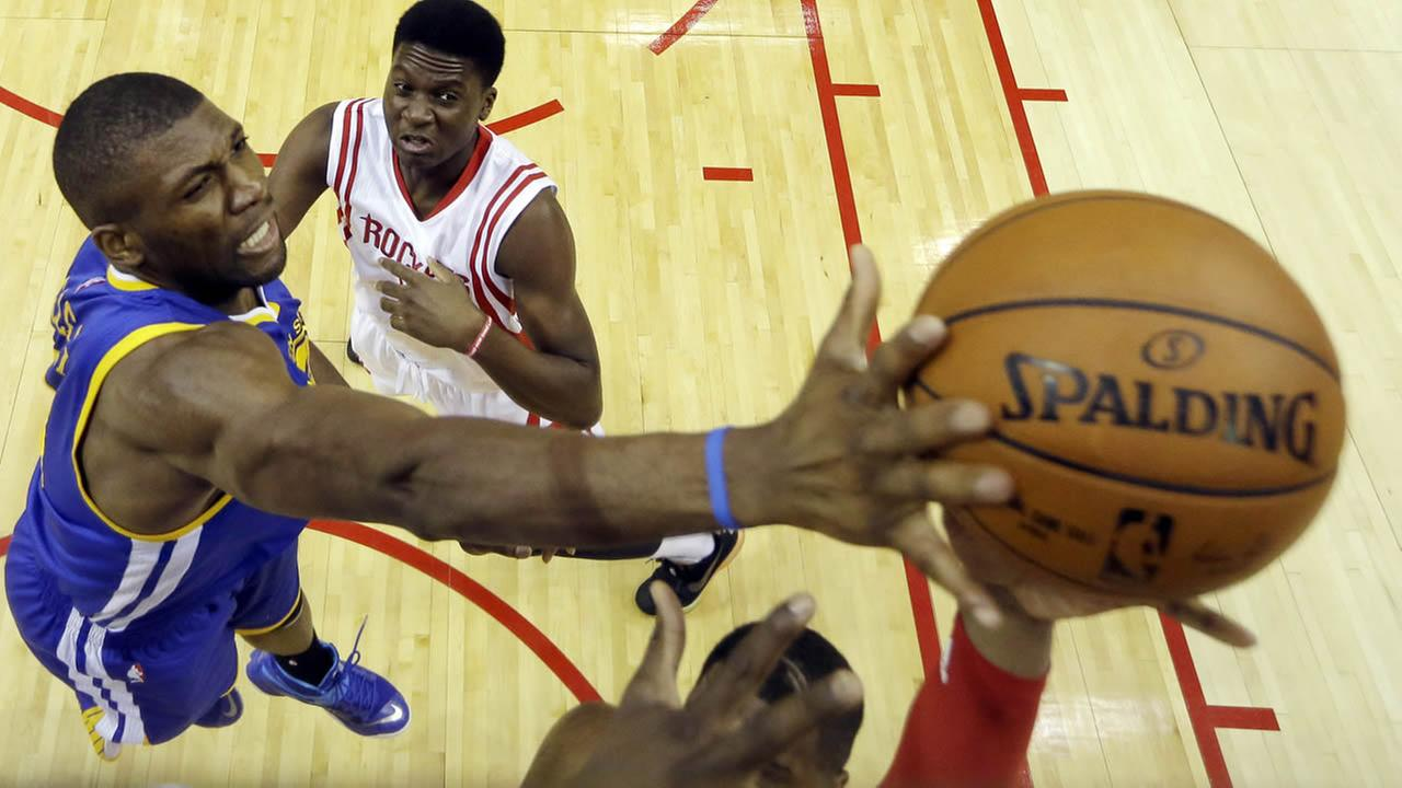 Warriors Festus Ezeli blocks a shot against the Rockets during the first half in Game 3 of the Western Conference finals of the NBA basketball playoffs on May 23, 2015, in Houston. (AP Photo)