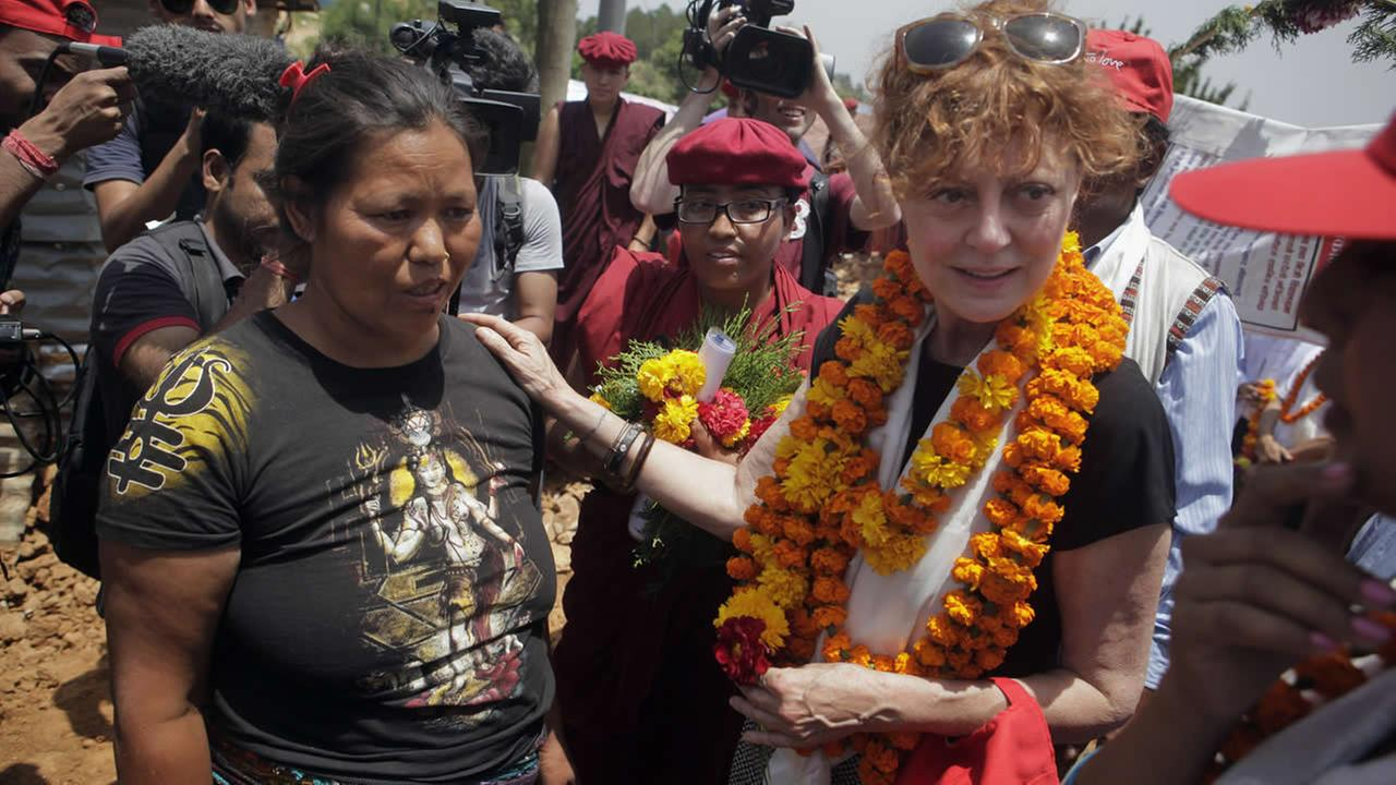 Oscar-winning Hollywood actress Susan Sarandon comforts Kanti Maya Tamang at Ramkot village on the outskirts of Kathmandu, Nepal, Sunday, May 24, 2015. (AP Photo/Niranjan Shrestha)