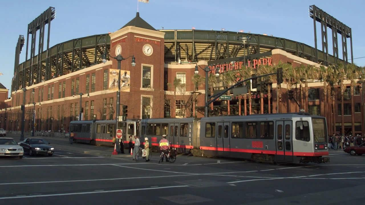 A MUNI streetcar rolls past the brick facade of the new Pacific Bell Park in San Francisco, in this March 31, 2000 photo. .(AP Photo/Eric Risberg)