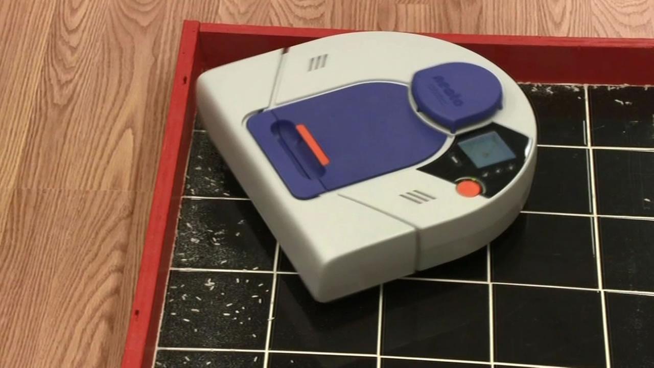 A robotic vacuum.
