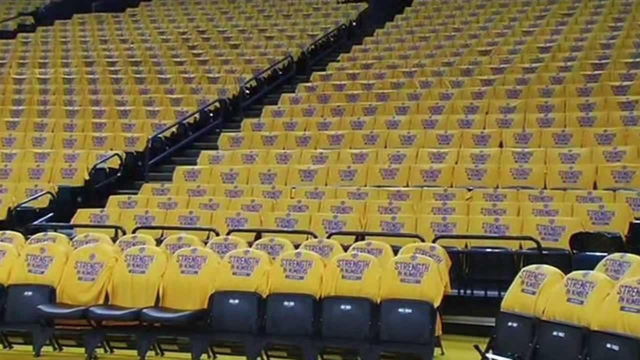 Spirit t-shirts cover the seats at Oracle Arena ahead of Game 5 of the Western Conference finals against the Houston Rockets on Wednesday, May 27, 2015 in Oakland, Calif.