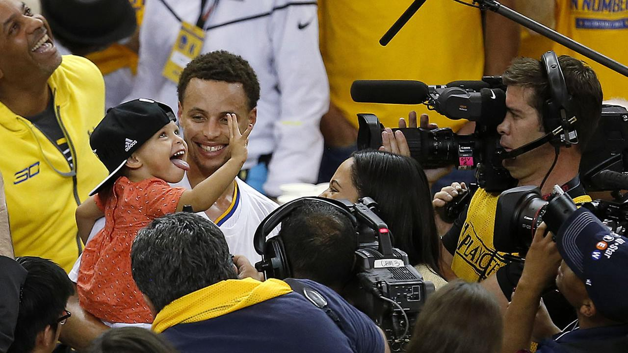 Golden State Warriors guard Stephen Curry holds his daughter Riley after Game 5 of the NBA basketball Western Conference finals against the Houston Rockets in Oakland, Calif.AP Photo/Tony Avelar