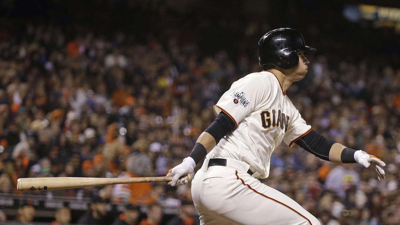 San Francisco Giants Joe Panik watches his two-run double off Atlanta Braves relief pitcher Brandon Cunniff during the eighth inning of a baseball game Thursday, May 28, 2015.