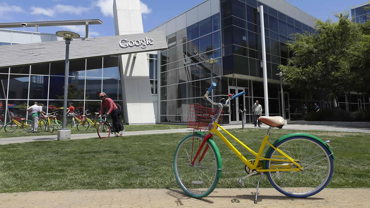 Employees travel around campus via bicycles at Google headquarters Tuesday, July 16, 2013, in Mountain View, Calif. (AP Photo/Ben Margot)