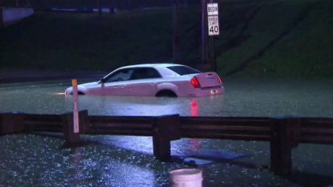 A car stuck in heavy flooding in Texas on Thursday, May 28, 2015.
