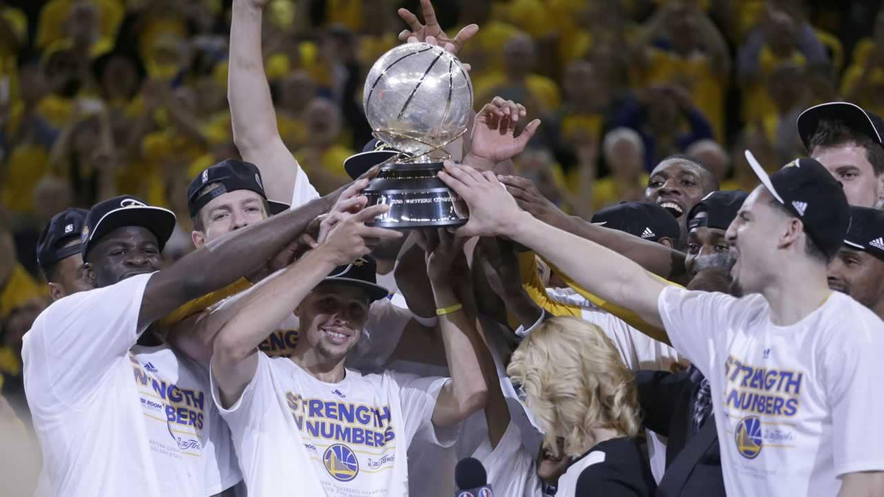 Warriors players celebrate after Game 5 of the NBA basketball Western Conference finals against the Houston Rockets in Oakland, Calif., Wednesday, May 27, 2015.