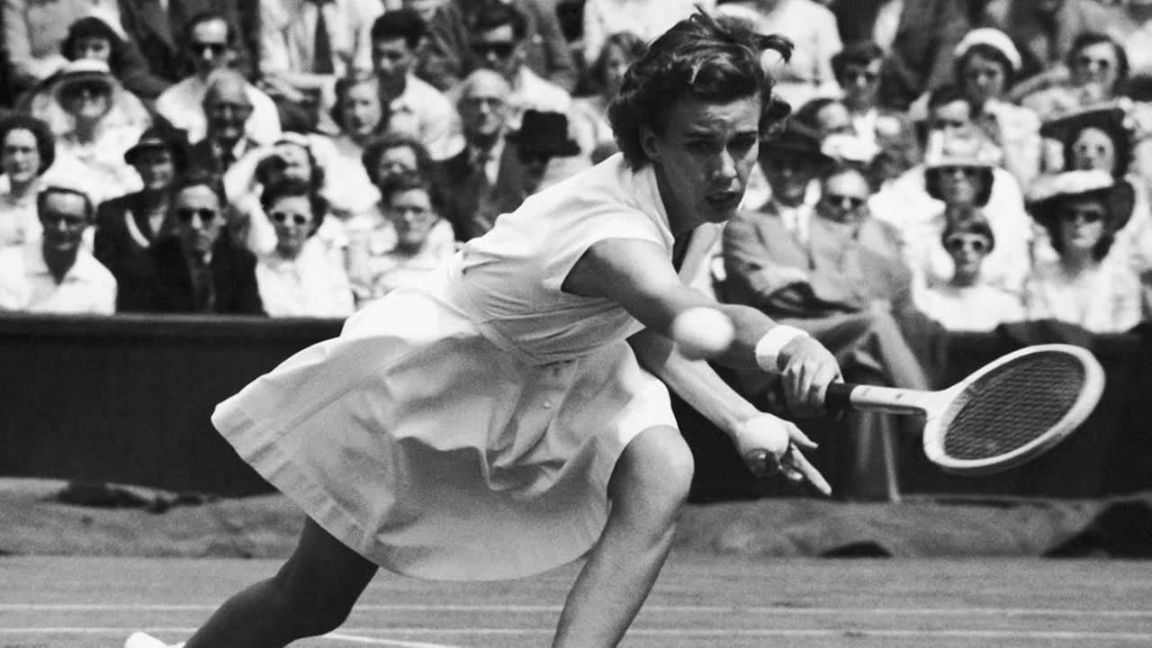 Miss Doris Hart, of Miami, Florida, seeded number three in the Womens Singles, strives to reach a return from her opponent, British Miss Jean Quertier on June 30, 1951.
