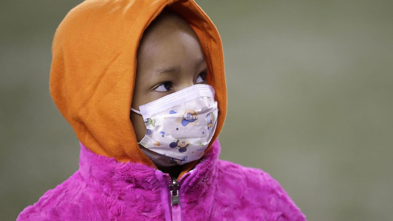 Leah Still watches during a ceremony in the first half of an NFL football game between the Cincinnati Bengals and the Cleveland Browns on Nov. 6, 2014, in Cincinnati. (AP Photo)