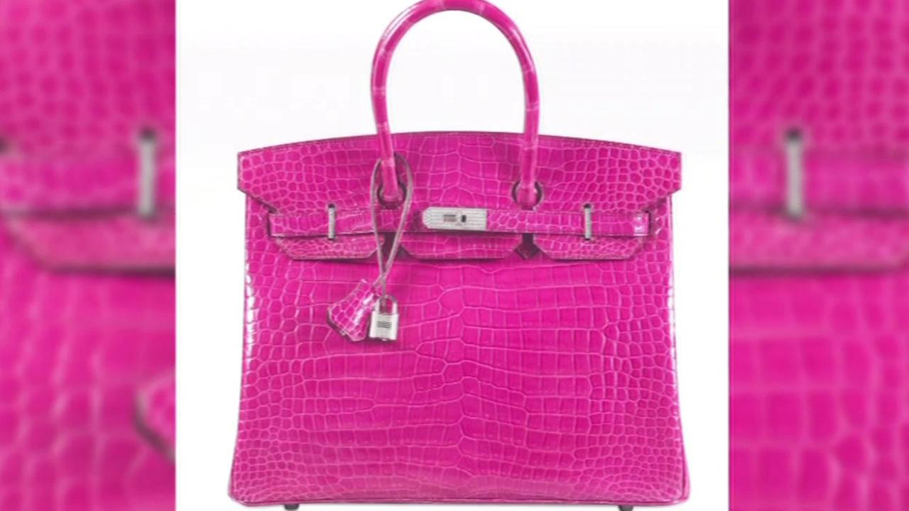 A diamond-encrusted Birkin Bag sold at a Christies auction house in Hong Kong for a record $222,000 on June 1, 2015.