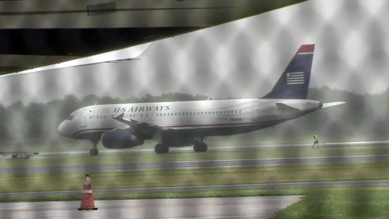 Bomb threat investigated on plane in Philadelphia.