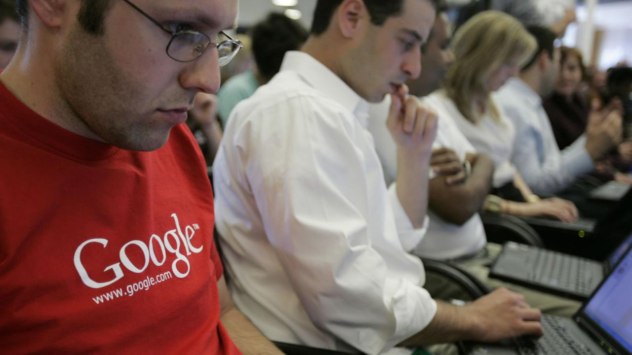 In this May 30, 2007 file photo, Google employees work on their laptops at Google headquarters in Mountain View, Calif.