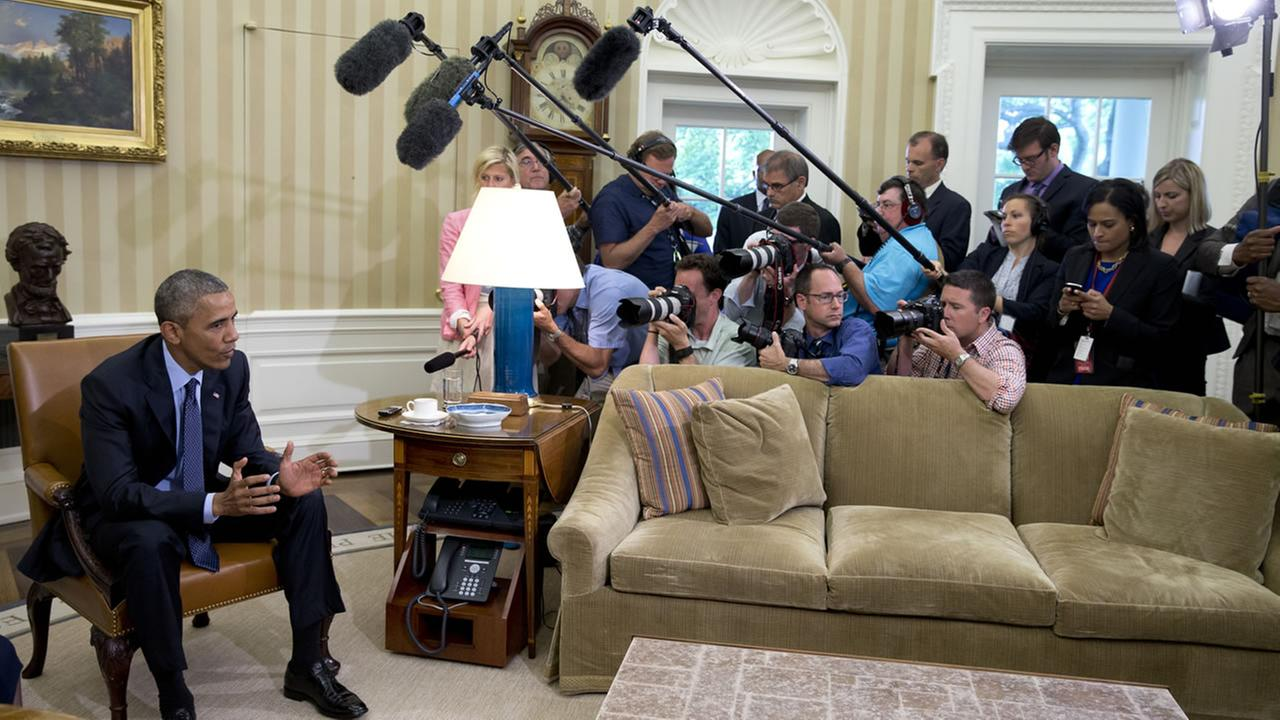 President Barack Obama speaks to media as he meets with Attorney General Loretta Lynch in the Oval Office of the White House