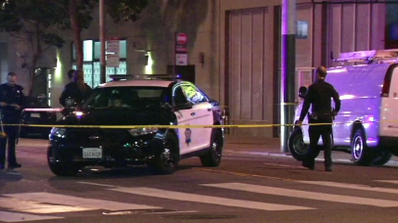 SFPD police cars, cops at scene of hit and run