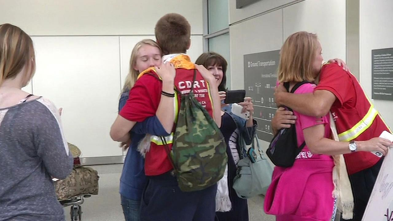 CDRT team hugging family at airport