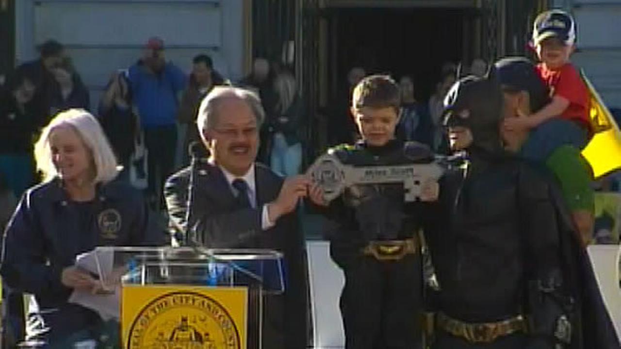 San Francisco Mayor Ed Lee awards Batkid with the key to the city on November 15, 2013.