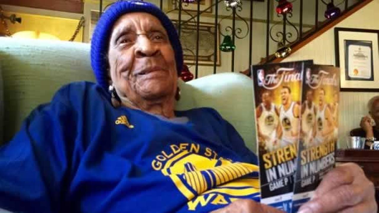The Golden State Warriors oldest fan, Sweetie, shows off her tickets to Game 1 of the NBA Finals against the Cleveland Cavaliers on Thursday, June 4, 2015.