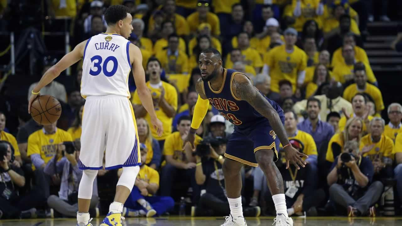 Cavaliers LeBron James  guards Warriors Stephen Curry during the first half of Game 1 of basketballs NBA Finals in Oakland, Calif., Thursday, June 4, 2015.AP Photo/Ben Margot