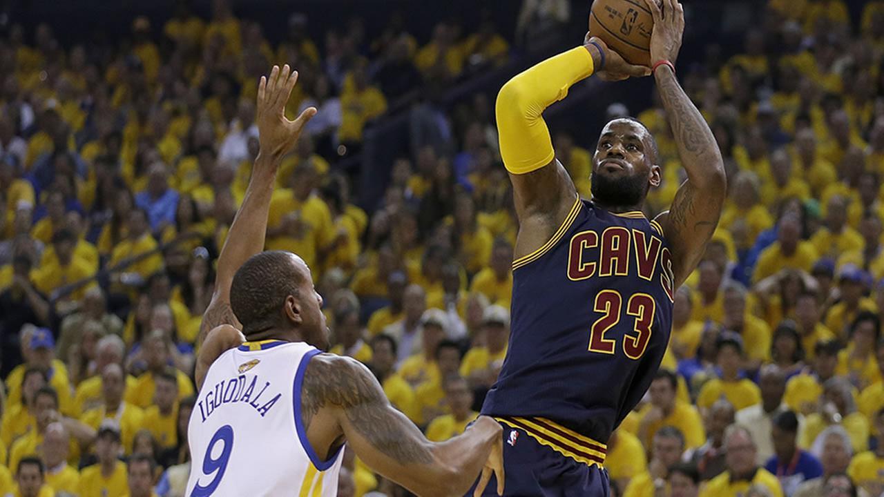 Cleveland Cavaliers forward LeBron James shoots against Golden State Warriors forward Andre Iguodala