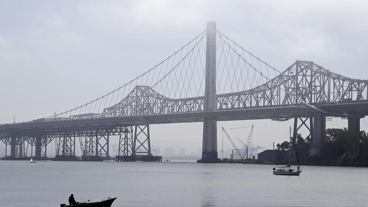 A pair of boats make their toward Clipper Cove on Treasure Island past the eastern span replacement of the San Francisco-Oakland Bay Bridge Friday, June 7, 2013 in San Francisco.