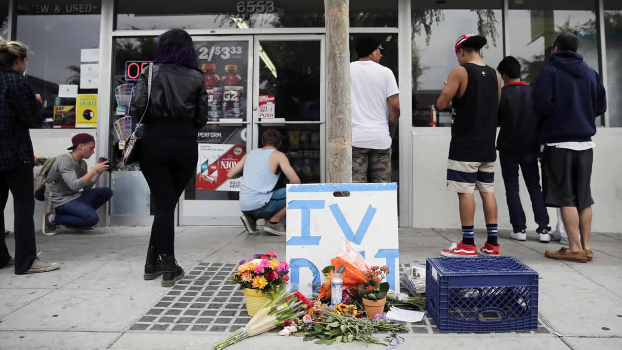 Some flowers are left in front of IV Deli Mart, where part of Friday nights mass shooting took place by a drive-by shooter, on Saturday, May 24, 2014  (AP Photo/Jae C. Hong)