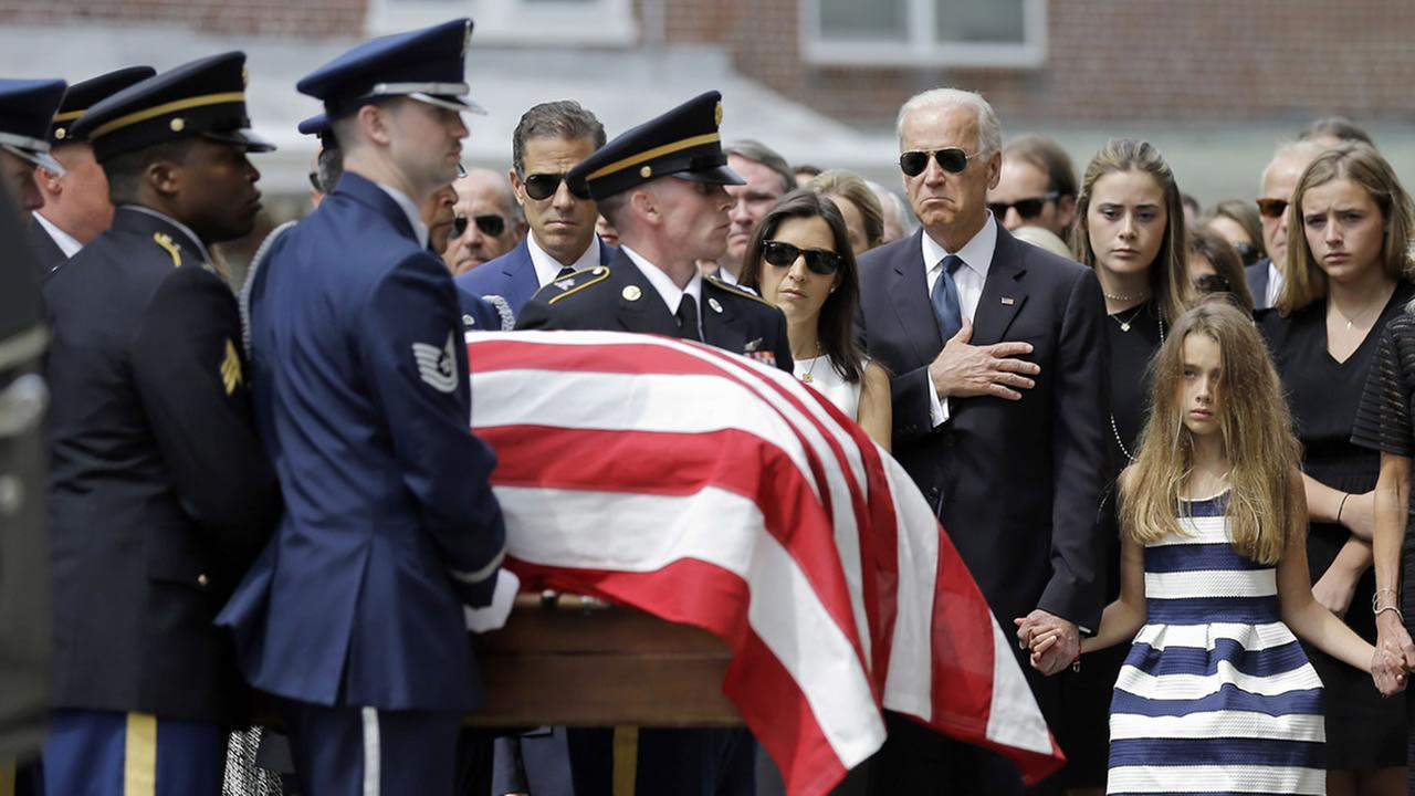 VP Joe Biden, accompanied by his family, watches an honor guard carry a casket containing the remains of his son, former Delaware Attorney General Beau Biden on June 6, 2015.