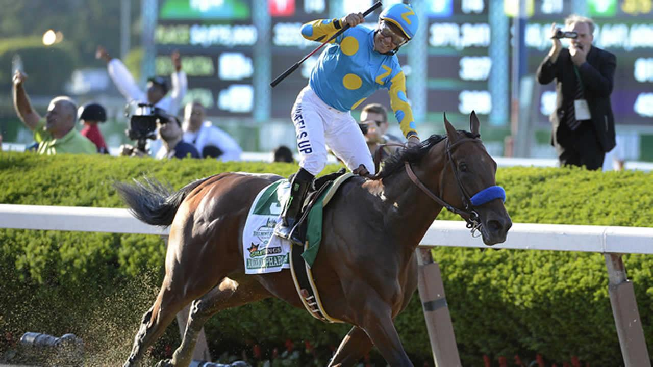 Victor Espinoza reacts after crossing the finish line with American Pharoah to win the Belmont Stakes at Belmont Park, Saturday, June 6, 2015, in Elmont, N.Y. (AP Photo)