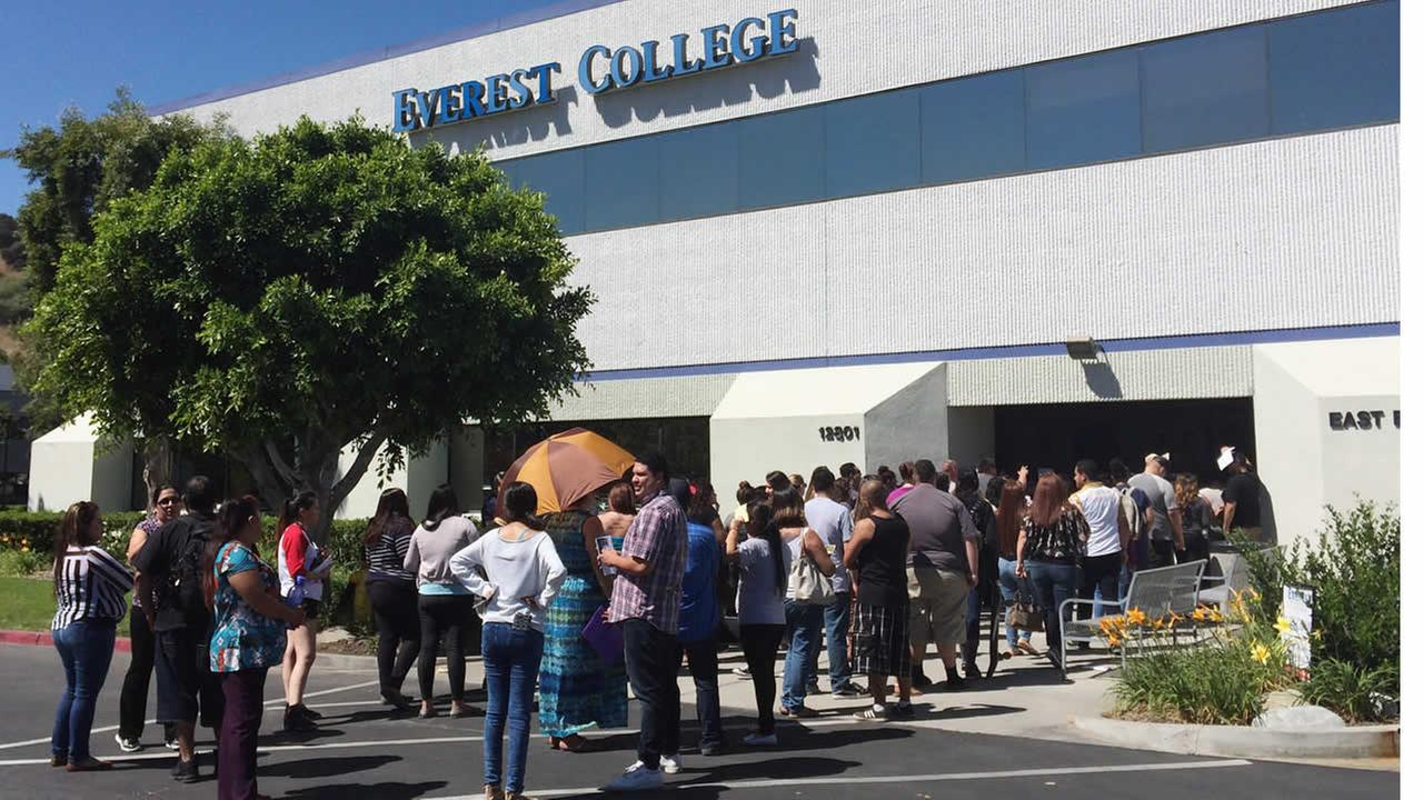 Students wait outside Everest College on April, 28, 2015 in Industry, Calif., hoping to get their transcriptions and information on loan forgiveness. (AP Photo/Christine Armario)