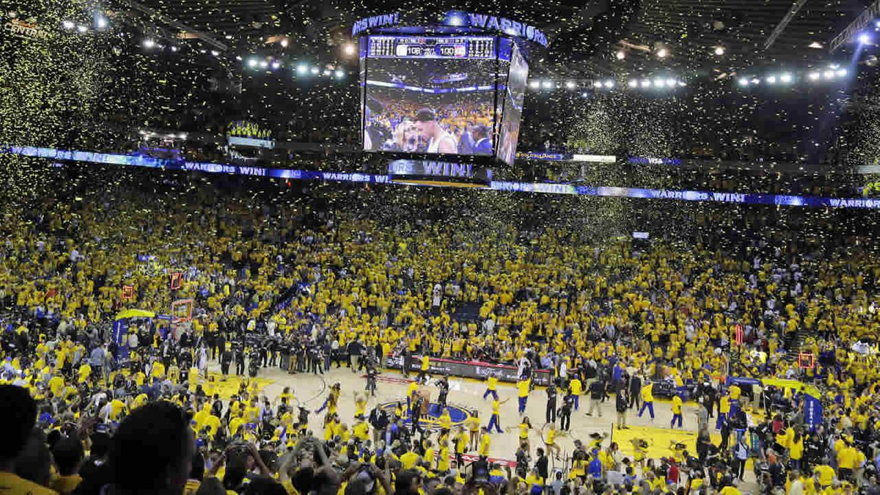 Confetti falls at Oracle Arena after Game 1 of the NBA Finals between the Golden State Warriors and the Cleveland Cavaliers in Oakland, Calif., June 4, 2015. (AP Photo/Eric Risberg)