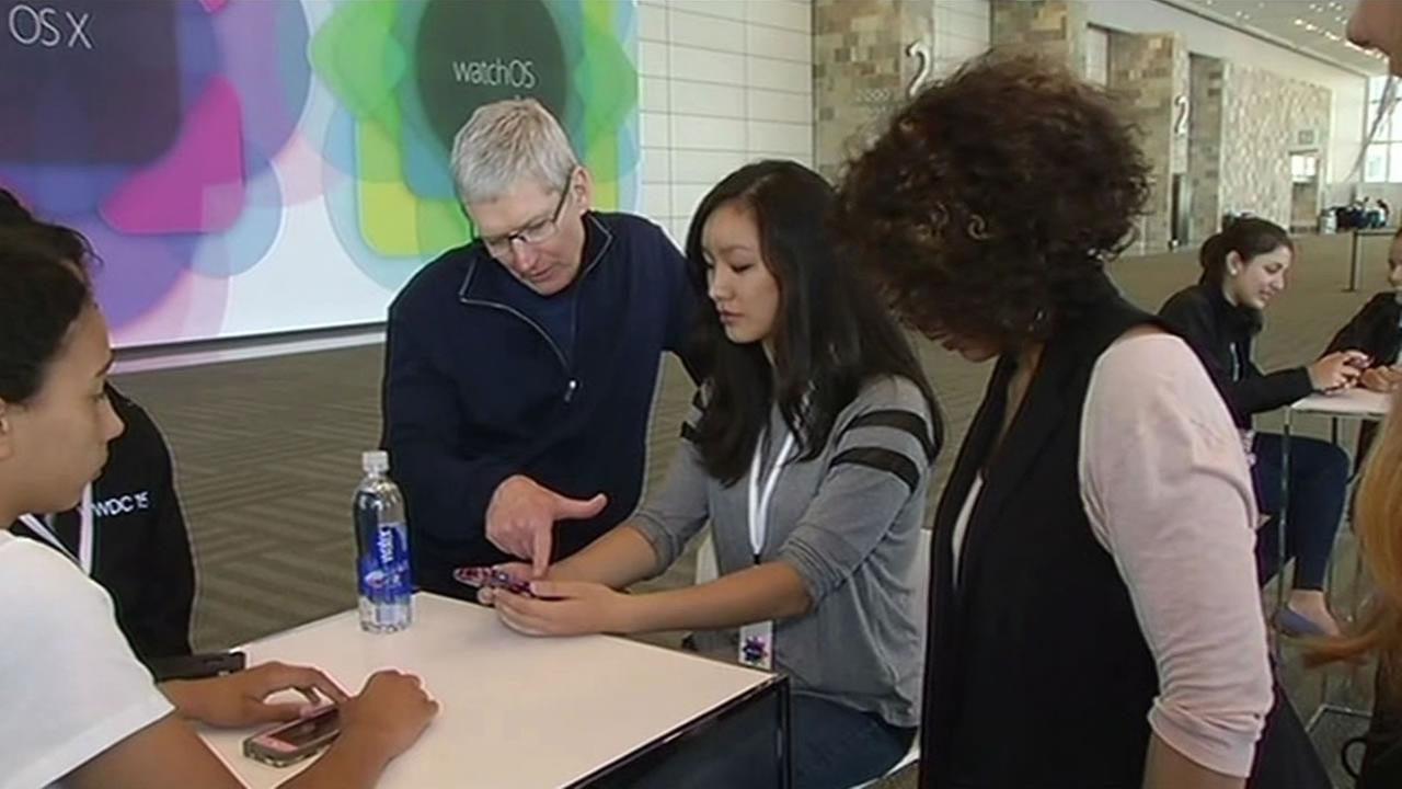 Apple CEO Tim Cook talks with high school students in San Francisco on June 7, 2015.